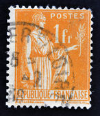FRANCE - CIRCA 1932: A stamp printed in France shows a woman with an Olive Branch in hand - allegory of Peace, circa 1932 — Stock Photo