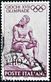 ITALY - CIRCA 1960: stamp printed in Italy shows Statue of the Seated boxer, circa 1960 — Stock Photo