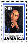 JAMAICA - CIRCA 1995: A stamp printed in Jamaica commemorating the 50th anniversary of the birth of Bob Marley, circa 1995 — Stock Photo