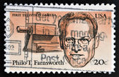 UNITED STATES OF AMERICA - CIRCA 1983: A stamp printed in USA shows first television camera and portrait of Philo T. Farnsworth (1906-1971) was an inventor and television pioneer,  circa 1983 — Foto Stock