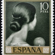 SPAIN - CIRCA 1965: stamp printed in Spain shows painting of Back of woman's head by Romero de Torres, circa 1965 — Stock Photo #42662719