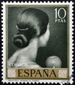 SPAIN - CIRCA 1965: stamp printed in Spain shows painting of Back of woman's head by Romero de Torres, circa 1965 — Stock Photo