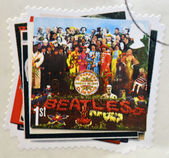 UNITED KINGDOM - CIRCA 2007: a postage stamp printed in Great Britain showing an image of The Beatles, Sgt. Peppers Lonely Hearts Club Band album cover, circa 2007. — Stock Photo