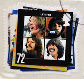 UNITED KINGDOM - CIRCA 2007: a postage stamp printed in Great Britain showing an image of The Beatles, Let It Be album cover, circa 2007. — Stock Photo