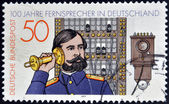 GERMANY - CIRCA 1977: stamp printed in Germany shows telephone operator, circa 1977. — Stock Photo