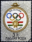 HUNGARY - CIRCA 1960: A stamp printed in Hungary shows emblem, devoted to the Olympic games in Rome, circa 1960 — Stock Photo