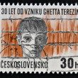 CZECHOSLOVAKIA - CIRCA 1972: A stamp printed in Czechoslovakia shows the Terezin concentration camp, Boy's head behind barbed wire, circa 1972 — Stock Photo #44905005