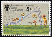 AUSTRALIA - CIRCA 1979: A stamp printed in Australia dedicated to the International Year of the Child shows Children playing on Slide, circa 1979. — Stock Photo