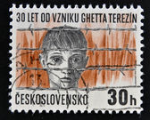 CZECHOSLOVAKIA - CIRCA 1972: A stamp printed in Czechoslovakia shows the Terezin concentration camp, Boy's head behind barbed wire, circa 1972 — Stock Photo