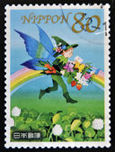 JAPAN - CIRCA 2011: A stamp printed in Japan dedicated to spring greeting, shows elf with flowers and rainbow, circa 2011 — Stock Photo