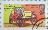 OMAN - CIRCA 1976: A stamp printed in State of Oman shows a american car, schacht 1908 usa, circa 1976 — Stock Photo