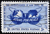 UNITED STATES OF AMERICA - CIRCA 1955: a stamp printed in USA shows Atomic Energy Encircling the Hemispheres, Atoms for Peace Policy, circa 1955 — Stock Photo