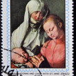 AJMAN - CIRCA 1970: Stamp printed in Ajman shows Madonna and child with St. Anna by Durer, circa 1970 — Stock Photo