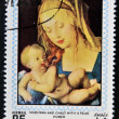 AJMAN - CIRCA 1970: Stamp printed in Ajman shows Madonna and child with a pear by Durer, circa 1970 — Stock Photo