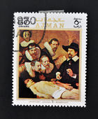 AJMAN - CIRCA 1970: A stamp printed in Ajman shows Anatomy lesson by Rembrandt, circa 1970 — Stock Photo