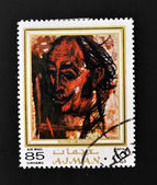 AJMAN - CIRCA 1970 A stamp printed in Ajman shows Dali portrait by Alexander Rutsch, circa 1970 — Stock Photo