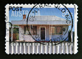 AUSTRALIA - CIRCA 2009: Australian stamp shows image of corrugated iron house, circa 2009 — Foto Stock