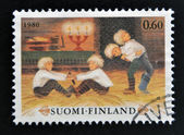 FINLAND - CIRCA 1980: stamp printed in Finland shows Boys playing Christmas Games, circa 1980 — Stock Photo