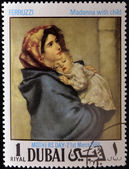 DUBAI - CIRCA 1968: A stamp printed in Dubai shows painting of Roberto Ferruzzi - Madonna with child, circa 1968 — Stok fotoğraf