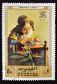 Iêmen - cerca de 1971: um selo imprimido em fujeira mostra a leiteira por johannes vermeer, circa 1968 — Foto Stock