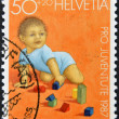 SWITZERLAND - CIRCA 1987: A stamp printed in Switzerland shows child playing with wooden figures, circa 1987 — Stock Photo #9444769