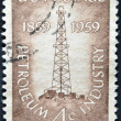 USA - CIRCA 1959 : A stamp printed in USA show Petroleum Industry with first oil well at Titusville, Pennsylvania, circa 1959 — Stock Photo #9445377