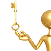 Holding gold key — Stock Photo