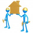 Construction Workers Holding Golden Home — Stock Photo #12351634