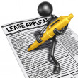 Filling Out Lease Application With Gold Pen — Stock Photo #12380080