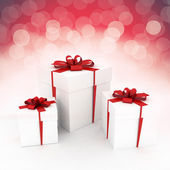 White gifts with red ribbon — Stock Photo