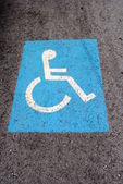 Blue road marking for disabled and invalid parking — Stock Photo
