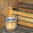 Wooden bucket full of water in a sauna — Stock Photo