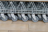 Wheels of trolleys in a row at the market — Stock Photo