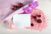 Bath salt, flowers and a blank card, concept of wellness — Stock Photo