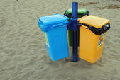 Colorful rubbish bins, on the sandy beach — Stock Photo