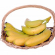 Bananas in a straw basket — Stock Photo