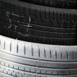 Stack of car tires as background — Stock Photo