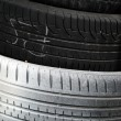 Stack of car tires as background - Stock Photo