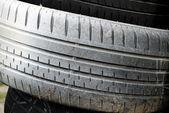 White car tires as background — Stock Photo