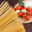 Raw spaghetti and tomatoes — Stock Photo #14880665