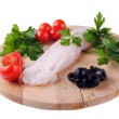 Cod steak with tomatoes olives and parsley isolated on white — Stock Photo