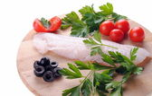 Cod steak with tomatoes olives and parsley isolated — Stock Photo