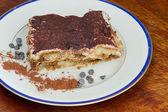 Tiramisu on wood — Stock Photo