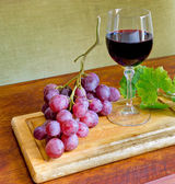 Wine, grape and leaves — Stock Photo