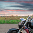 Motorcycle at sunset - Stock Photo