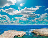Rocky coast and clouds — Foto Stock