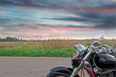 Motorcycle at sunset — Stock Photo