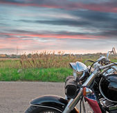 Motorcycle at sunset — Stok fotoğraf