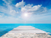 Pier and clouds — Stock Photo