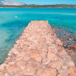 Pier made with stone in Brandinchi — Stock fotografie #23794773